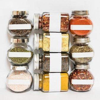 Jars with spices and herbs arrangement