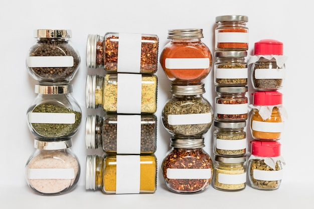 Jars with spices and herbs assortment