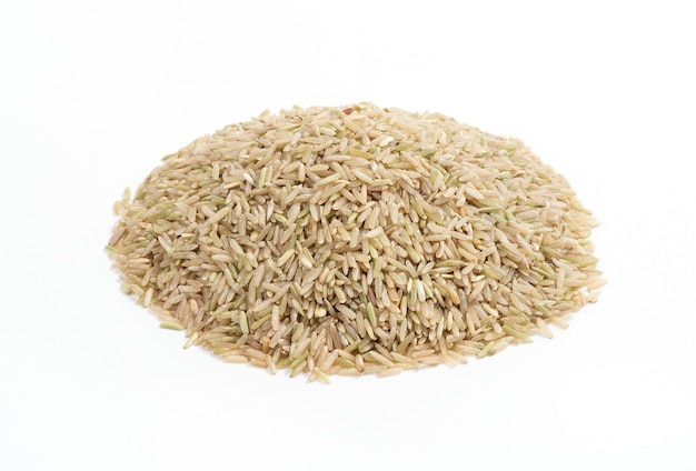 Jasmine brown rice isolated on a white surface.