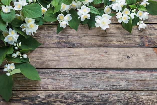 Jasmine flowers on wooden table