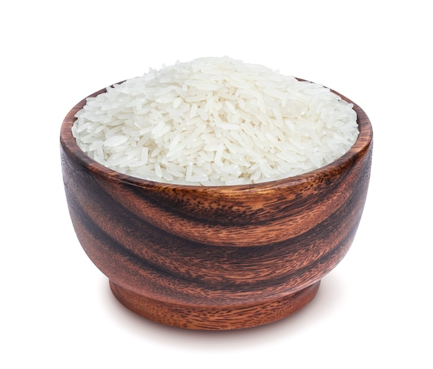 Jasmine rice in wooden bowl isolated on white background