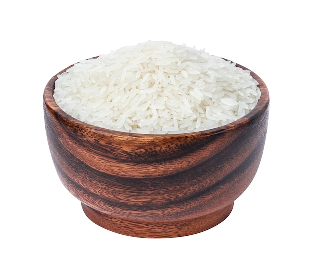 Jasmine rice in wooden bowl isolated on white