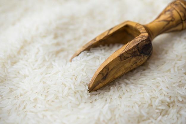 Jasmine rice in a wooden scoop