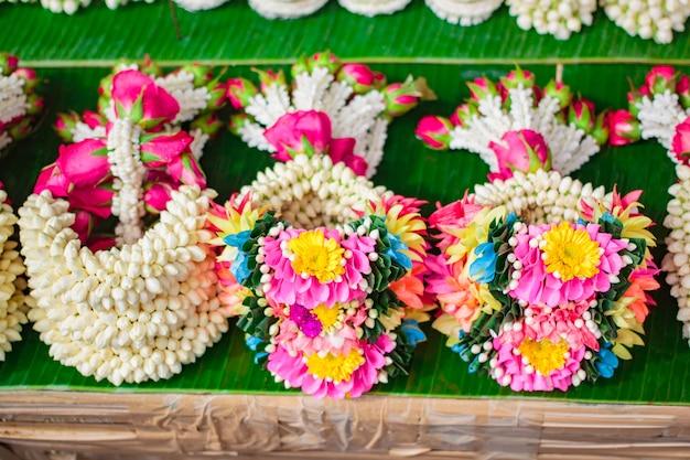 Jasmine rose garland, steering wheel of jasmine flower at street market in thailand.