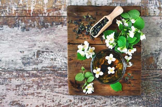 Jasmine tea with flowers and leaves