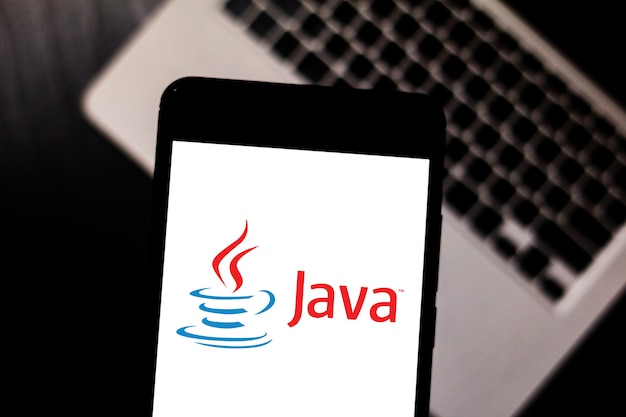 Java logo is displayed on a smartphone.