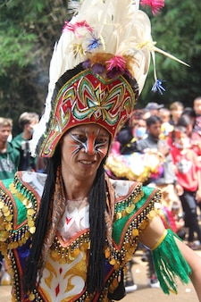 Javanese traditional dance with feather mask topeng
