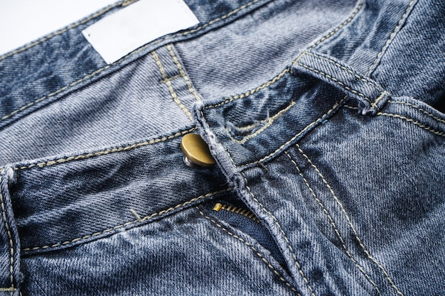 Jeans background, denim with seam of fashion design, place for text.