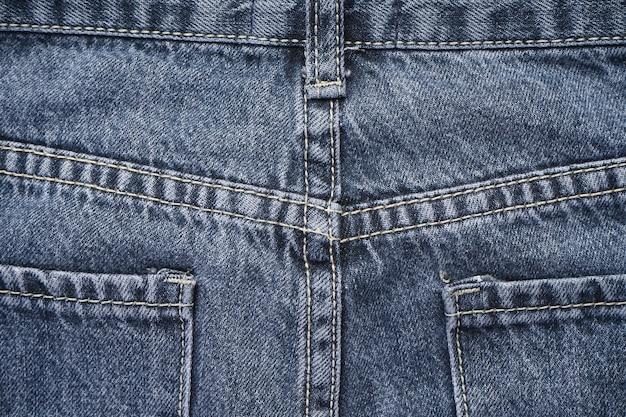 Jeans background, denim with seam of fashion design