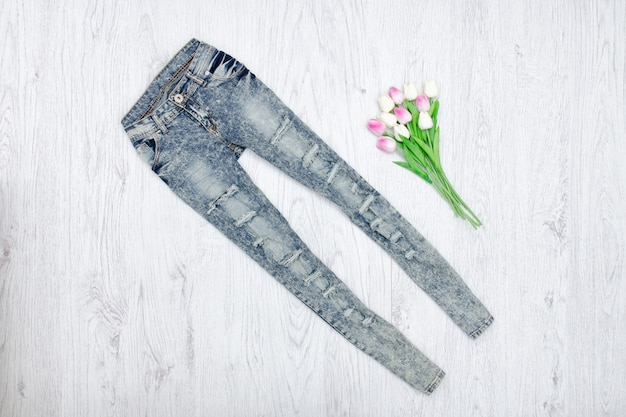 Jeans and a bouquet of tulips.