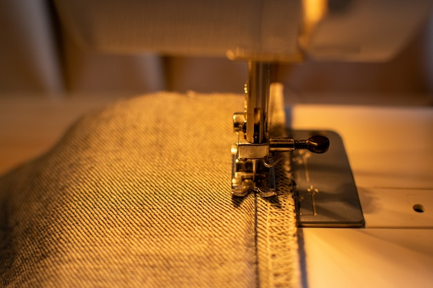 Jeans fabric on the sawing machine ready to saw