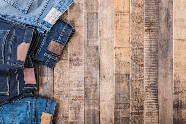 Jeans on old wood panel background