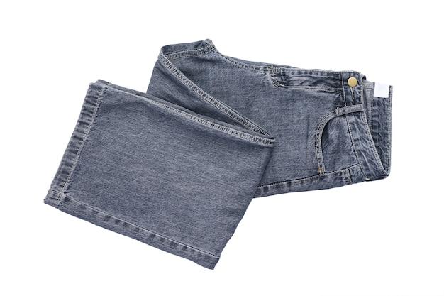 背景のジーンズ。白い孤立した背景、上面図のジーンズ。
