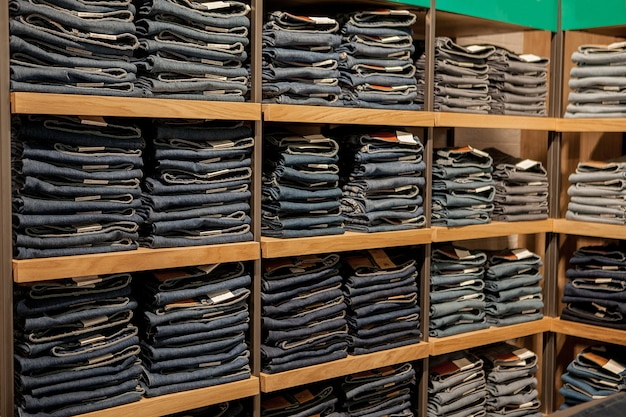 Jeans pants on the store shelf. blue jeans denim collection jeans stacked