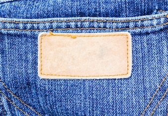 Jeans pants with brown leather tag empty for your text