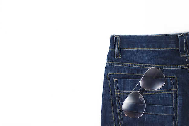 Jeans pocket closeup with sun glasses. sun glasses in a back pocket of a jeans.