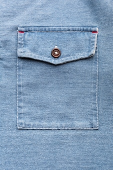 A jeans pocket with plastic button