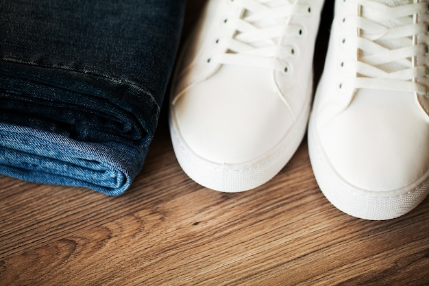 Jeans and sneakers on the store shelf.
