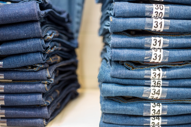 Jeans stacked on a shelf