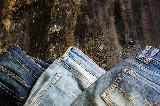 Jeans stacked on a wooden chair