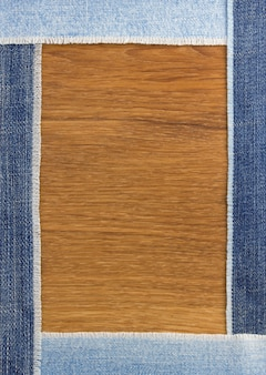 Jeans strips at wooden texture background
