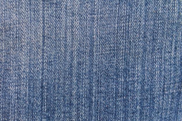 Предпосылка текстуры джинсов. часть синих джинсов