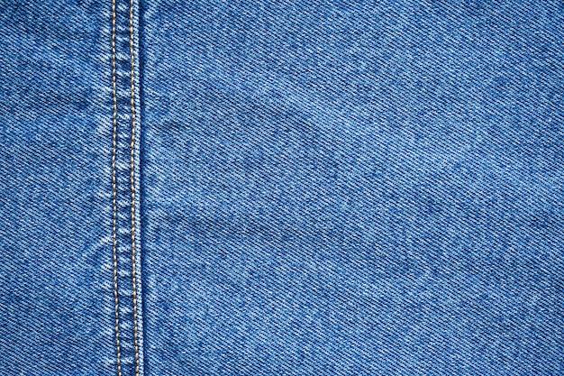 ジーンズの質感。青い背景、デニムジーンズの背景。