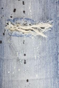 Jeans torn denim texture.