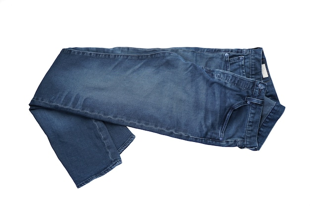Jeans on a white isolated background, top view. jeans on the background.