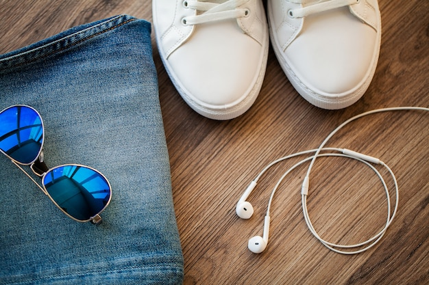Jeans and white sneakers on the store shelf
