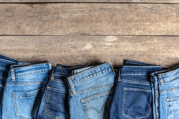 Jeans on wooden table