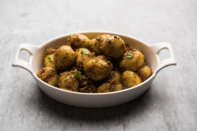 Jeera aloo - potatoes flavoured with cumin seeds and spices. popular indian main course recipe. served in a bowl. selective focus
