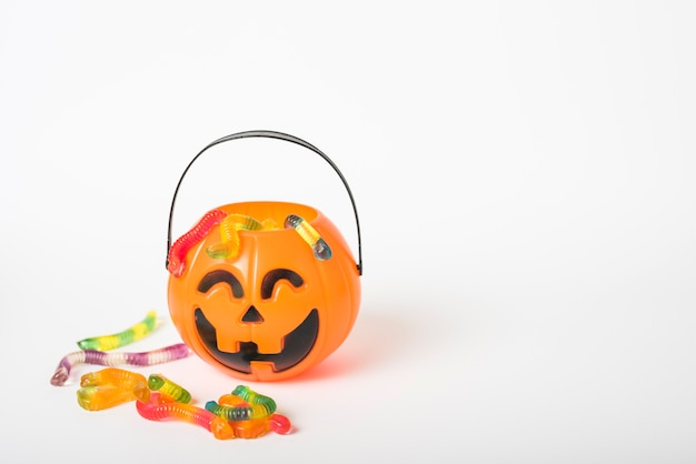 Jelly candies near jack-o-lantern basket