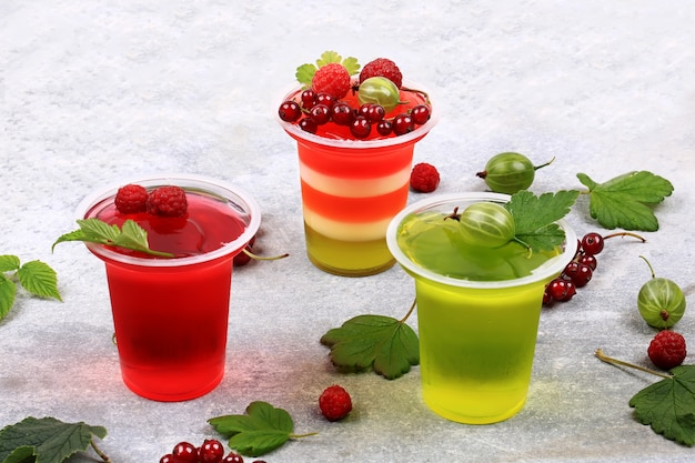 Jelly pudding with berries in glasses