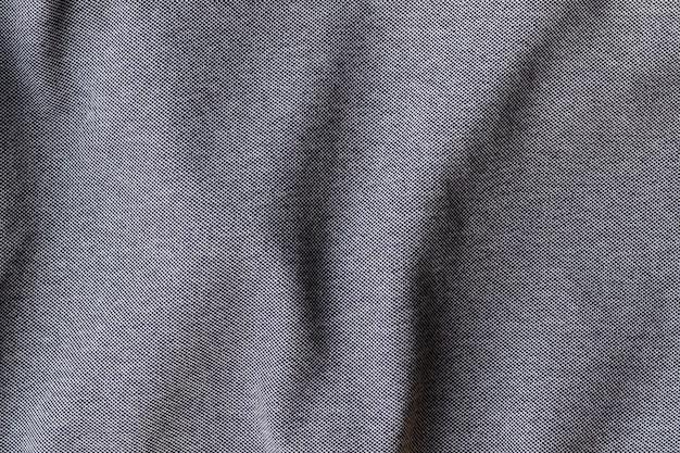 ジャージーコットン生地の風合い。しわくちゃの灰色のテキスタイルの背景