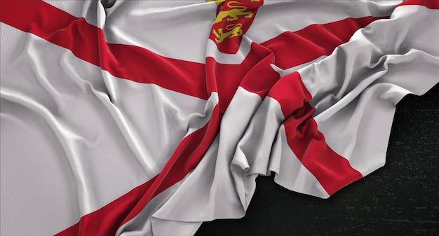 Jersey flag wrinkled on dark background 3d render