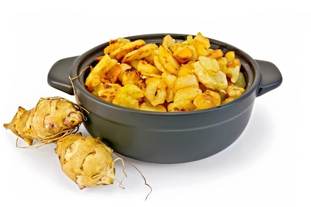 菊芋をローストパンでローストし、菊芋の新鮮な塊茎を分離