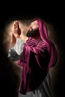 Jesus christ praying to god with hand gesture