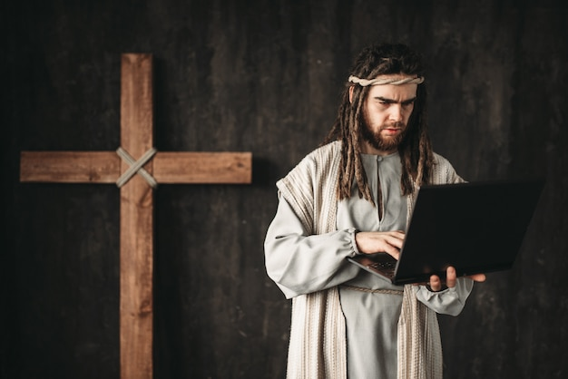 Jesus christ uses laptop