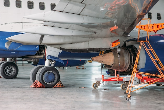 Jet airplane in hangar, inspection before flight