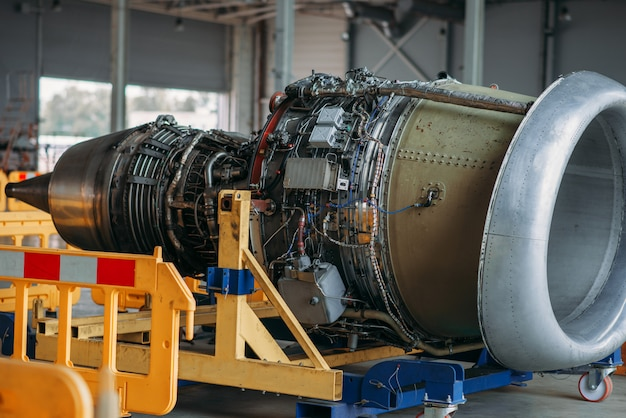 Jet airplane turbine on repairing in hangar