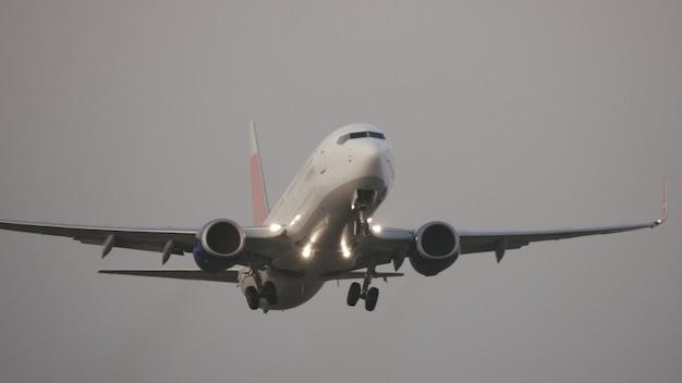 Jet plane departure on a snowy runway