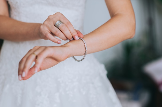 Jeweler bracelet on the bride's hand