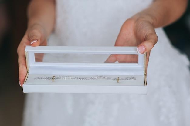 Jeweler bracelet on the bride's hand