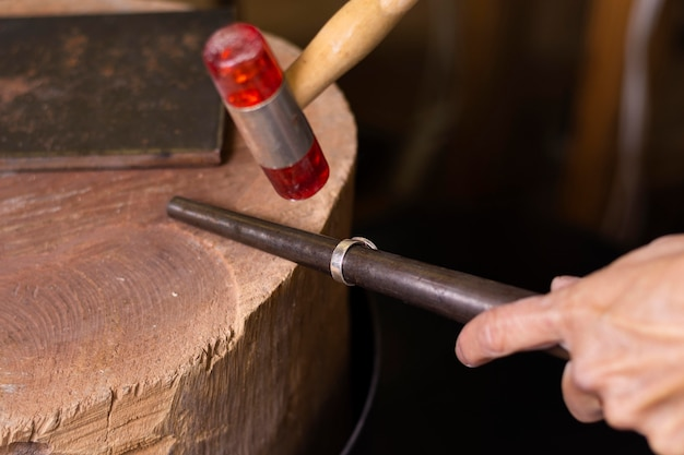 Jeweler hands measuring a ring