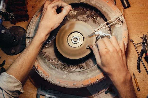 Jewellery polishing a stone blue cubic zirconia