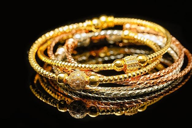 Jewelry and bracelets on black background