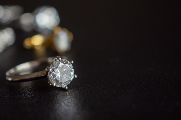 Jewelry diamond rings set on black background close up