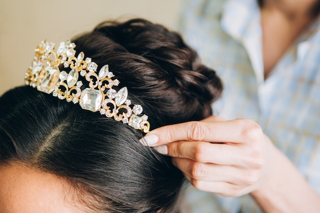 Jewelry for hair. golden hair comb. wedding hairstyle, dark hair. barber job