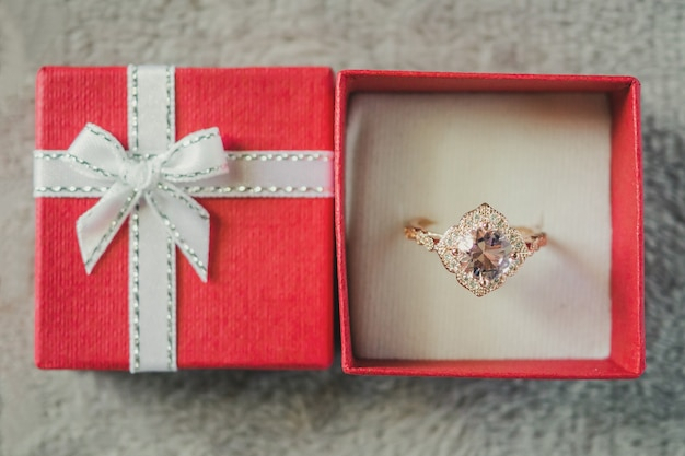 Jewelry pink diamond ring in red gift box